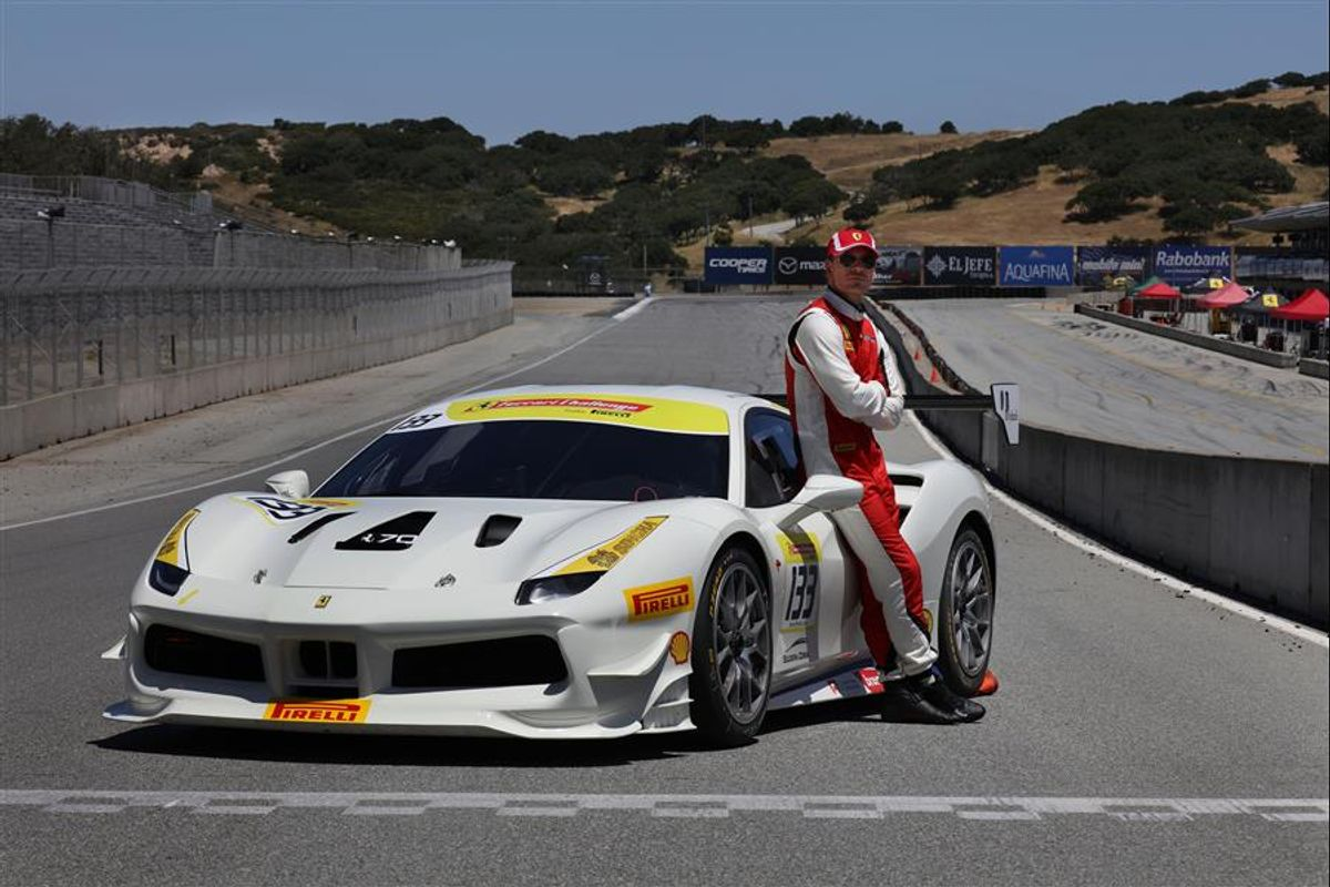 Actor Michael Fassbender races with Ferrari