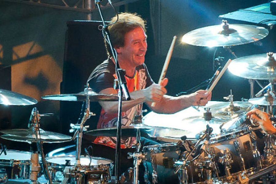 Unleash Your Inner Rock Star: With  a 1 hr drumming session with rock legend Kenney Jones